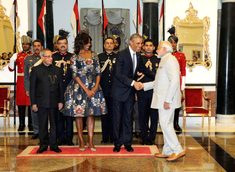 Prime Minister Narendra Modi at the banquet hosted in honour of US President Barack Obama and First Lady Michelle Obama by President Pranab Mukherjee, at Rashtrapati Bhavan, in New Delhi .. - Narendra Modi and Pranab Mukherjee