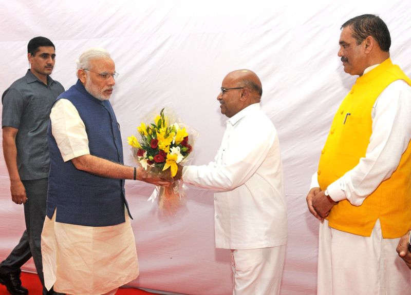 Prime Minister Narendra Modi being received by the Union Minister for Social Justice and Empowerment, Thaawar Chand Gehlot on his arrival, at the foundation stone laying Ceremony of Dr. ... - Narendra Modi