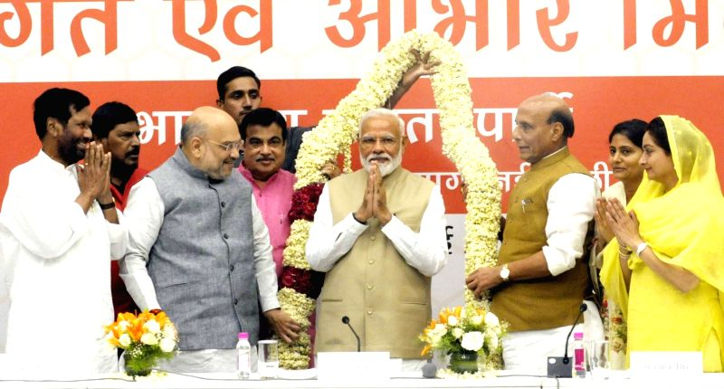 New Delhi: Prime Minister Narendra Modi being greeted by BJP chief Amit Shah and Union Ministers Ram Vilas Paswan, Ramdas Athawale, Nitin Gadkari, Rajnath Singh, Anupriya Patel and Harsimrat Kaur Badal during Union Council of Ministers meeting at the