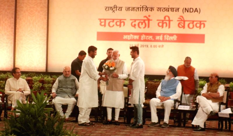 New Delhi: Prime Minister Narendra Modi being welcomed by Union Minister and Lok Janshakti Party (LJP) president Ram Vilas Paswan along with his son Chirag Paswan during NDA dinner hosted by BJP chief Amit Shah at Ashoka Hotel in New Delhi on May 21,