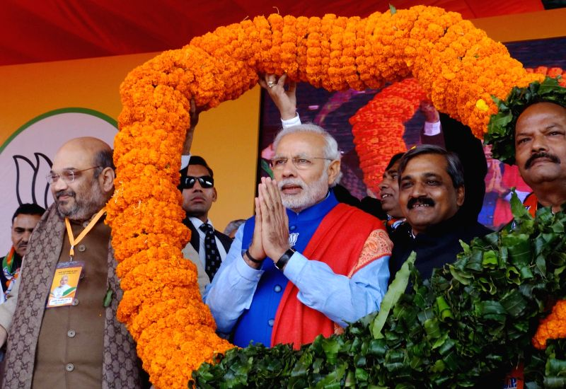 Prime Minister Narendra Modi, BJP chief Amit Shah, Delhi BJP chief Satish Upadhyay and Jharkhand Chief Minister Raghubar Das during a BJP rally to celebrate party's success in the recently - Narendra Modi, Amit Shah and Satish Upadhyay