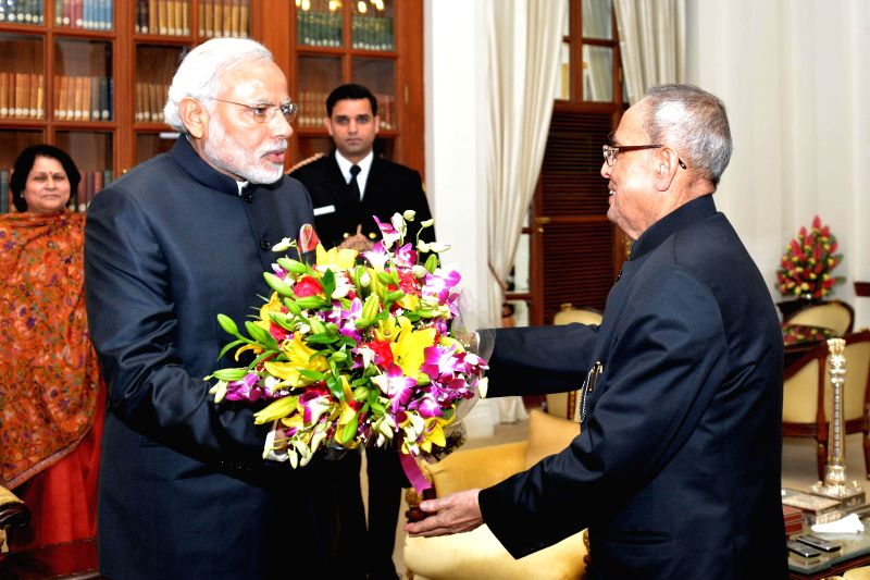 Prime Minister Narendra Modi calls on President Pranab Mukherjee to wish him on new year at Rashtrapati Bhavan in New Delhi, on Jan 1, 2015. - Narendra Modi and Pranab Mukherjee