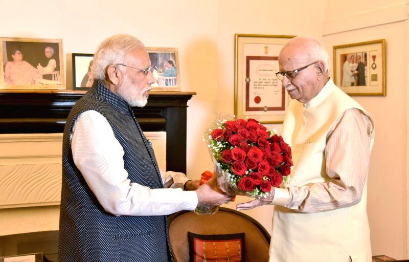 New Delhi: Prime Minister Narendra Modi calls on senior BJP leader LK Advani to greet him on his 90th birthday, in New Delhi on Nov 8, 2017. (Photo: IANS/PIB)