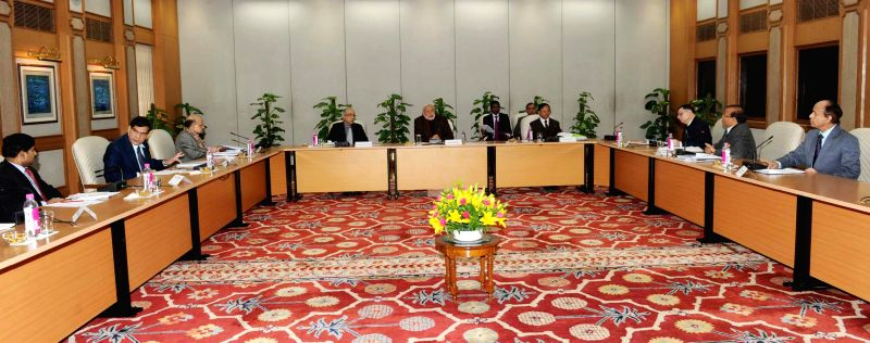 Prime Minister Narendra Modi chairs a high-level meeting with the Government officials regarding the SmartCity initiative, in New Delhi on Dec 29, 2014. - Narendra Modi