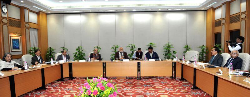 Prime Minister Narendra Modi chairs a review meeting on tribal welfare, in New Delhi on Jan 20, 2015. - Narendra Modi