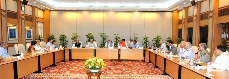 Prime Minister Narendra Modi chairs a high-level meeting to review the situation following earthquake in Nepal; in New Delhi on April 25, 2015. The Union Home Minister Rajnath Singh and ... - Narendra Modi, Rajnath Singh and Arun Jaitley