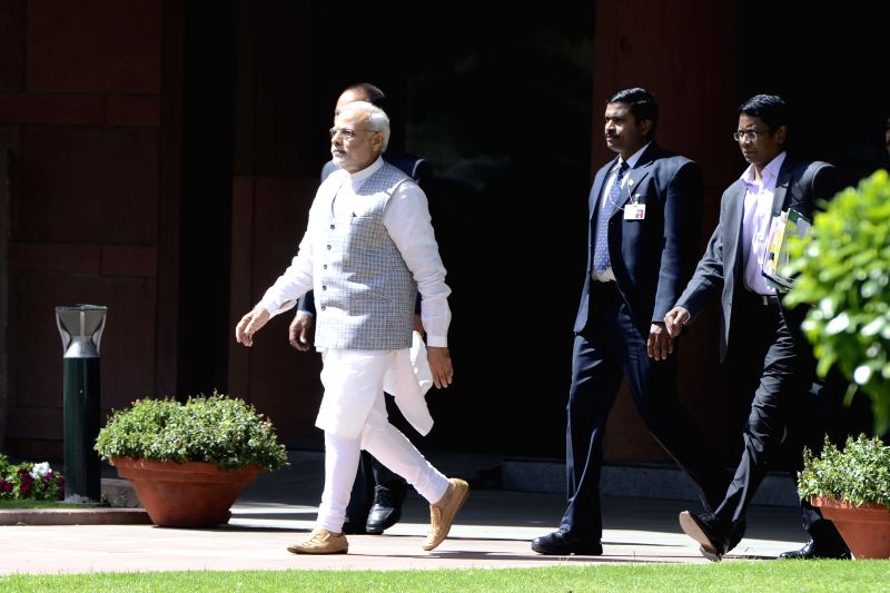 Prime Minister Narendra Modi comes out the Parliament Library building after meeting West Bengal Chief Minister Mamata Banerjee in New Delhi on March 9, 2015. - Narendra Modi