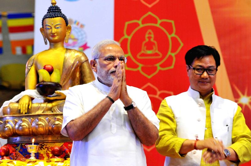 Prime Minister Narendra Modi during Buddha Purnima celebrations at the Talkatora Stadium in New Delhi, on May 4, 2015. Also seen MoS Home Affairs Kiren Rijiju. - Narendra Modi