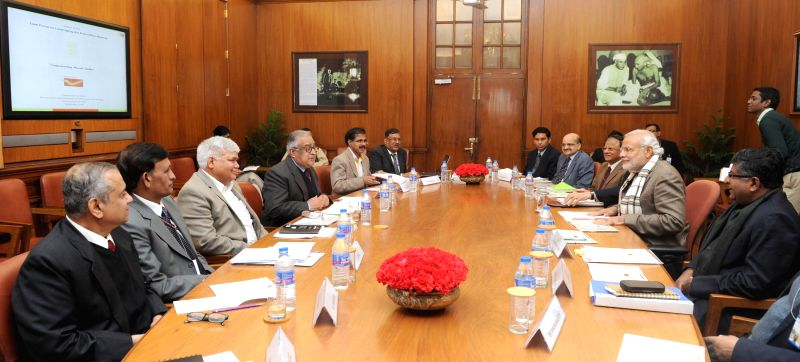 Prime Minister Narendra Modi during a meeting on leveraging of the post office network in New Delhi on Jan 7, 2015. - Narendra Modi