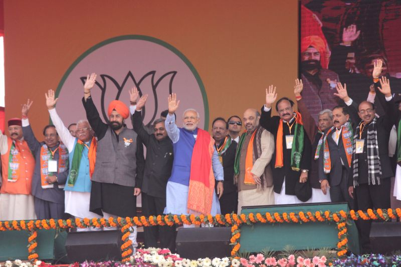 Prime Minister Narendra Modi during a BJP rally to celebrate party's success in the recently concluded assembly polls in Jharkhand and Jammu and Kashmir at Ramlila Maidan in New Delhi on .. - Narendra Modi, M. Venkaiah Naidu, Manohar Lal Khattar, Satish Upadhyay, Amit Shah and Jitendra Singh