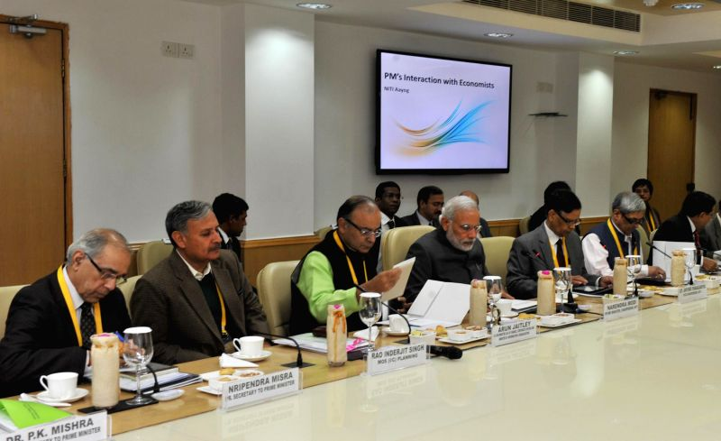 Prime Minister Narendra Modi during an interaction with economists, at NITI Aayog, in New Delhi on Feb 6, 2015. Also seen the Union Minister for Finance, Corporate Affairs and Information . - Narendra Modi and Arun Jaitley