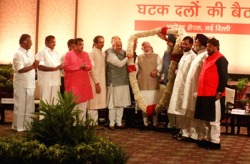 New Delhi: Prime Minister Narendra Modi during NDA dinner hosted by BJP chief Amit Shah at Ashoka Hotel in New Delhi on May 21, 2019. Also seen Tamil Nadu Chief Minister K Palaniswami, Deputy Chief Minister O Panneerselvam, Shiv Sena President Uddhav