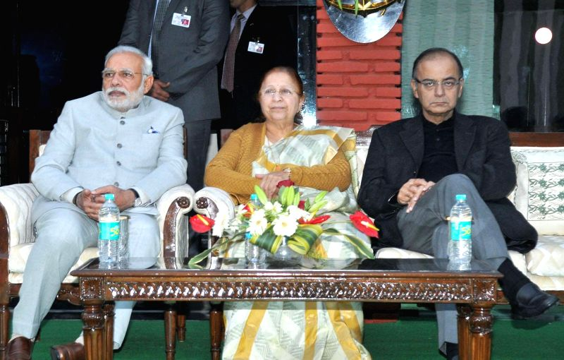Prime Minister Narendra Modi during the 'At Home' reception, organised by the Chief of Naval Staff, Admiral R.K. Dhowan on Navy Day, in New Delhi on Dec 4, 2014. Also seen  Union Minister . - Narendra Modi, Arun Jaitley and Sumitra Mahajan