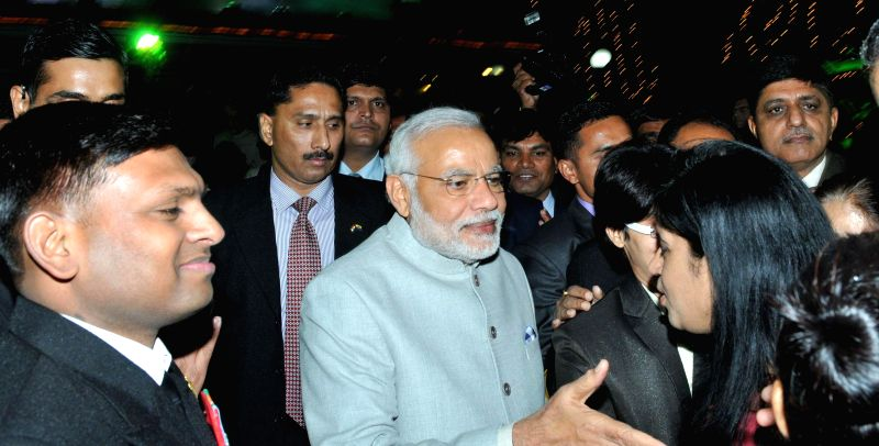 Prime Minister Narendra Modi during the 'At Home' reception, organised by the Chief of Naval Staff, Admiral R.K. Dhowan on Navy Day, in New Delhi on Dec 4, 2014. - Narendra Modi