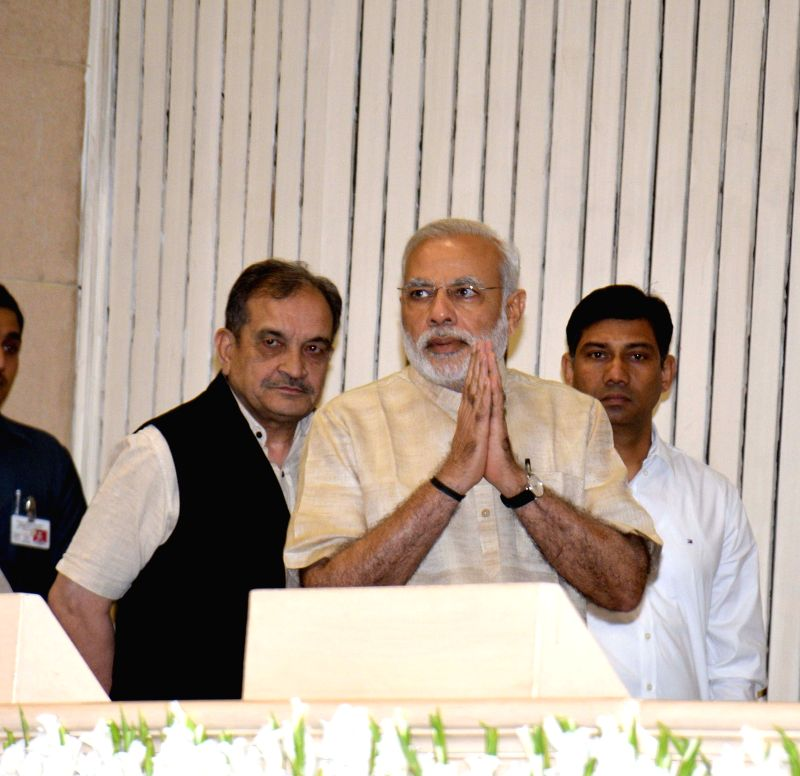 Prime Minister Narendra Modi during the National Panchayati Raj Day function, in New Delhi on April 24, 2015. Also seen the Union Minister for Rural Development, Panchayati Raj, Drinking ... - Narendra Modi and Chaudhary Birender Singh
