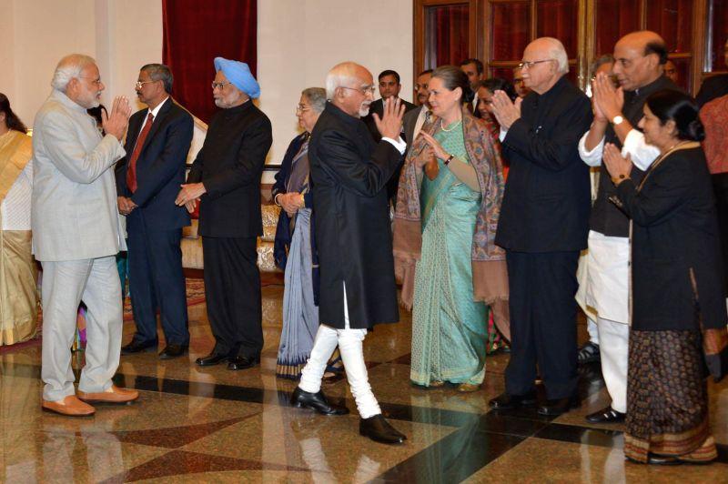 Prime Minister Narendra Modi, former prime minister Manmohan Singh,  Vice-President Mohammad Hamid Ansari, Congress chief Sonia Gandhi,  veteran politician and MP from Gandhinagar L K ... - Narendra Modi, Sushma Swaraj, Manmohan Singh, Sonia Gandhi, Rajnath Singh and Pranab Mukherjee