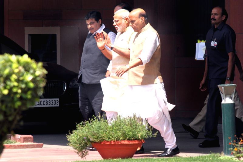 Prime Minister Narendra Modi, Home Minister Rajnath Singh and Transport minister Nitin Gadkari after the Union Cabinet  meeting at Parliament House on May 05,2015. - Narendra Modi and Rajnath Singh