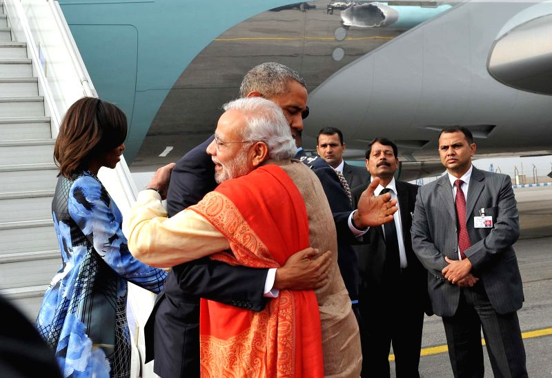 Prime Minister Narendra Modi hugs US President Barack Obama to welcome the latter on his arrival in India, in New Delhi, on Jan 25, 2015.Also seen  the First Lady of US Michelle Obama. - Narendra Modi