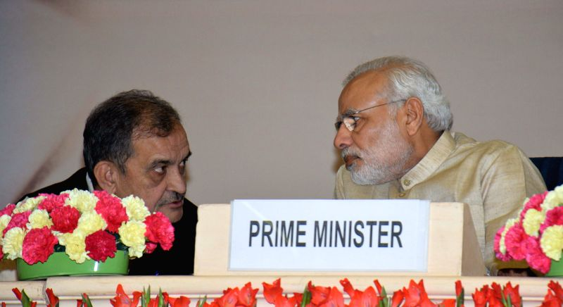 Prime Minister Narendra Modi interacts with the Union Minister for Rural Development, Panchayati Raj, Drinking Water and Sanitation Chaudhary Birender Singh during the National Panchayati ... - Narendra Modi and Chaudhary Birender Singh