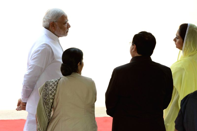 Prime Minister Narendra Modi interacts with External Affairs Minister Sushma Swaraj, at the ceremonial reception, at Rashtrapati Bhavan, in New Delhi on June 19, 2015. - Narendra Modi