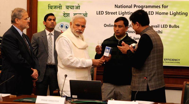 Prime Minister Narendra Modi launch the National Programme for LED Street Lighting and LED Home Lighting, in New Delhi on Jan. 05, 2015. Also seen Lt. Governor Delhi Najeeb Jung and the ... - Narendra Modi