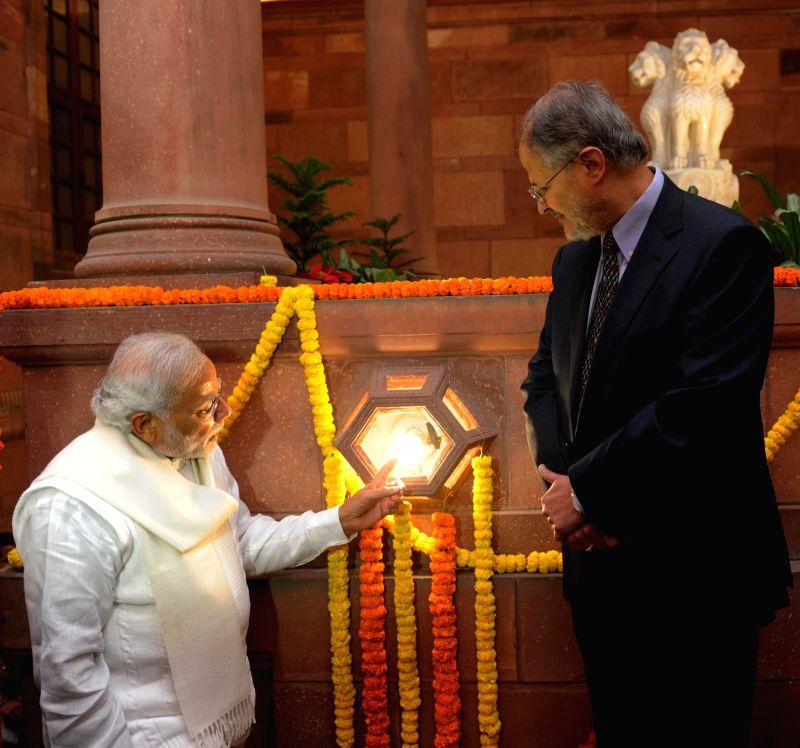 Prime Minister Narendra Modi launch the National Programme for LED Street Lighting and LED Home Lighting, in New Delhi on Jan. 5, 2015. Also seen Lt. Governor Delhi Najeeb Jung is. - Narendra Modi