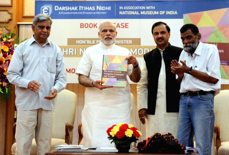 Prime Minister Narendra Modi launches a book on ``Pre-Modern Kutchi Navigation Techniques and Voyages``, in New Delhi on April 6, 2015. Also seen Minister of State for Culture (Independent ... - Narendra Modi and Mahesh Sharma