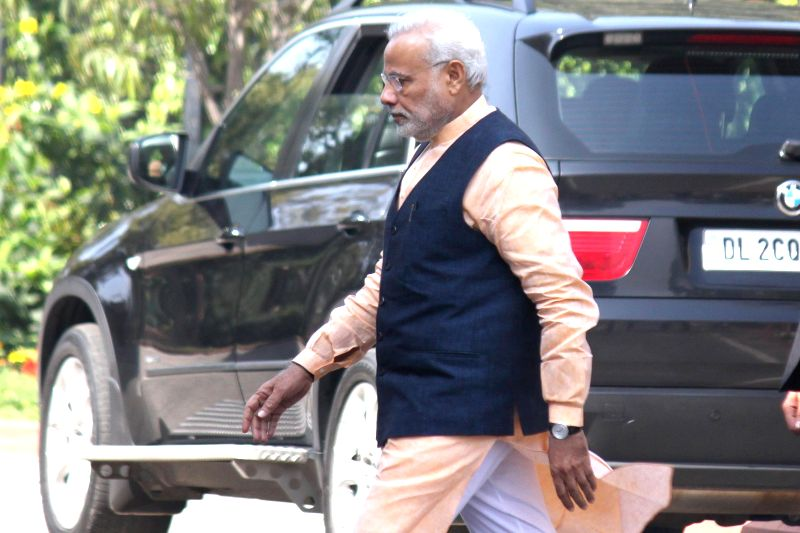 Prime Minister Narendra Modi leaves after attending the BJP parliamentary meeting at Parliament library in New Delhi, on March 10, 2015. - Narendra Modi