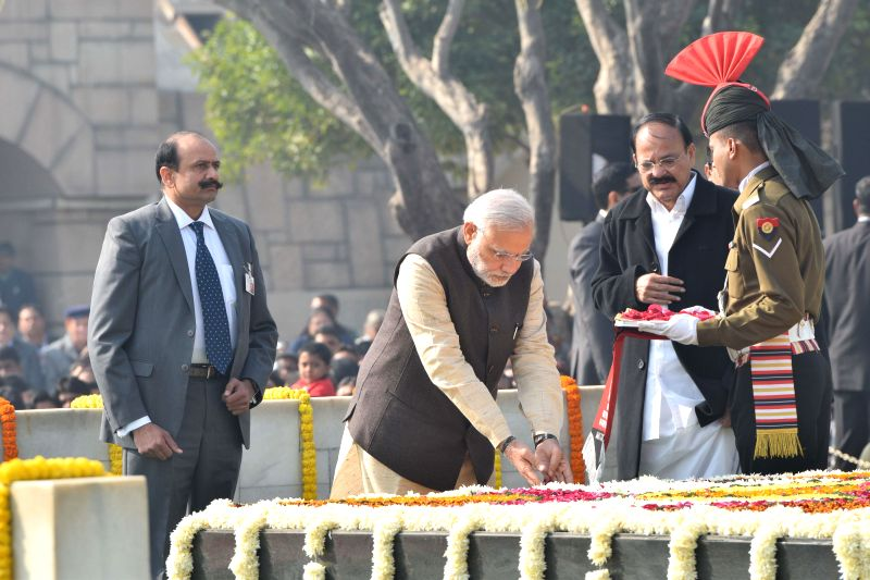 Prime Minister Narendra Modi paying homage at the Samadhi of Mahatma Gandhi on the occasion of Martyr's Day, at Rajghat, in Delhi on January 30, 2015. - Narendra Modi