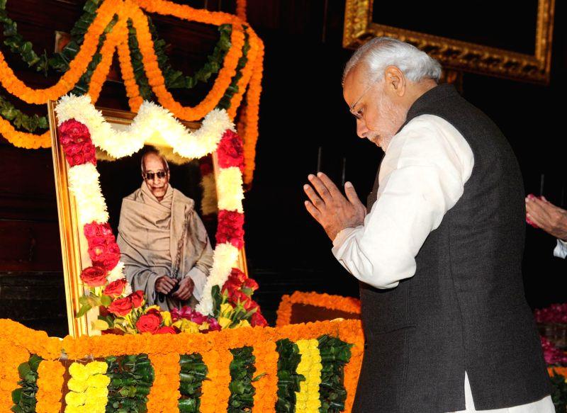 Prime Minister Narendra Modi pays homage at the portrait of C. Rajagopalachari on his birth anniversary, at Parliament House, in New Delhi on Dec 10, 2014. - Narendra Modi