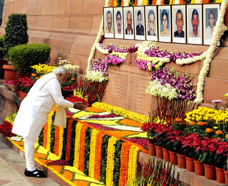 Prime Minister Narendra Modi pays homage to Parliament attack martyrs on its 13th anniversary in New Delhi on Dec. 13, 2014. - Narendra Modi
