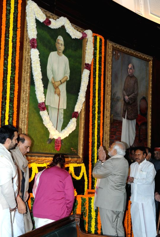Prime Minister Narendra Modi pays tribute to former Prime Minister, Late Charan Singh on his 112th birth anniversary at the Parliament House, in New Delhi on Dec. 23, 2014. Also seen Union - Narendra Modi and Rajnath Singh