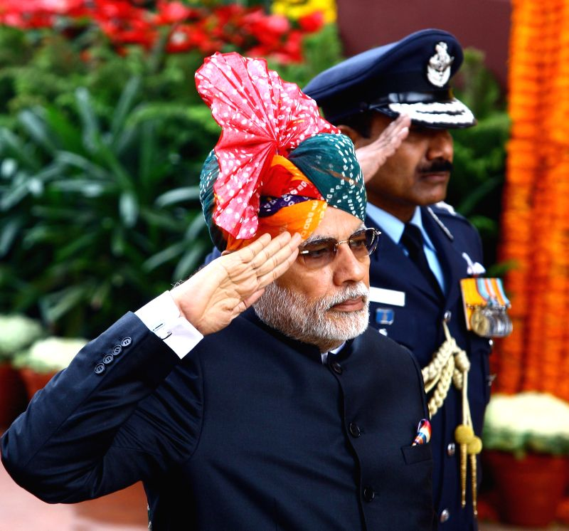 Prime Minister Narendra Modi pays homage at the Amar Jawan Jyoti, India Gate, on the occasion of the 66th Republic Day Parade 2015, in New Delhi on Jan 26, 2015. - Narendra Modi