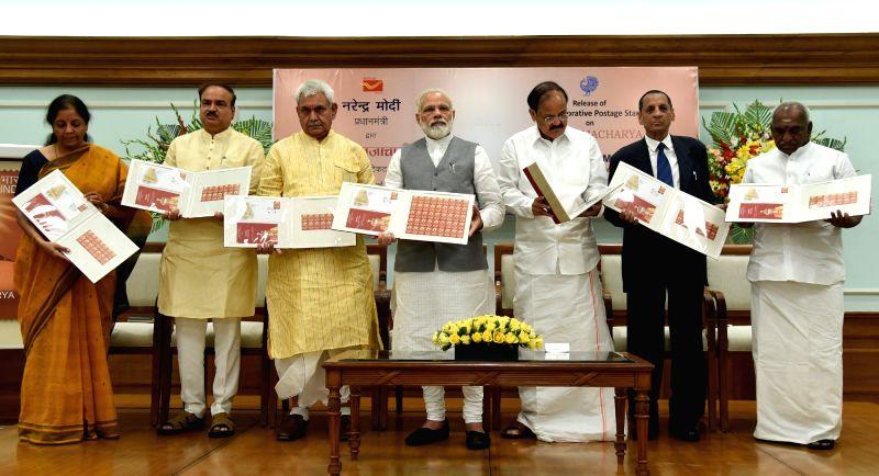 New Delhi: Prime Minister Narendra Modi release the commemorative Stamp on Ramanujacharya, in New Delhi on May 1, 2017. Also seen Telangana and Andhra Pradesh Governor ESL Narasimhan, the ... - Narendra Modi, M Venkaiah Naidu, Affairs Ananth Kumar and Manoj Sinha