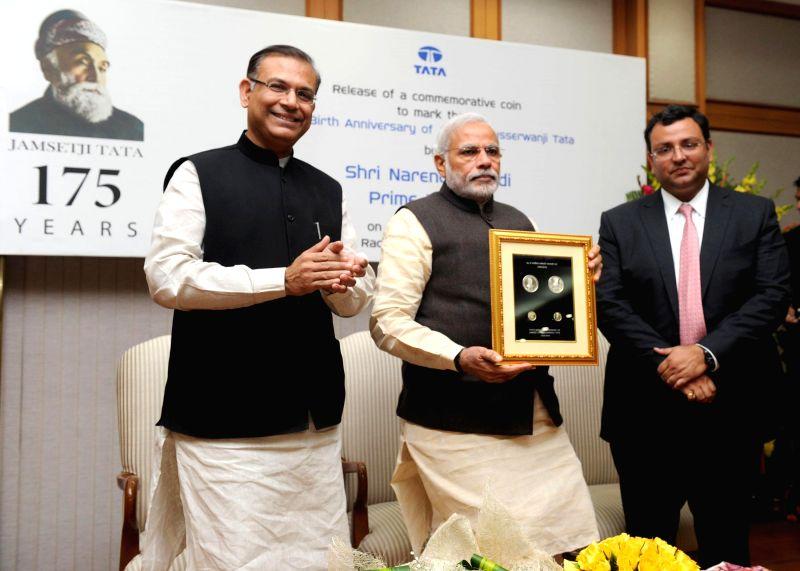 Prime Minister Narendra Modi releases the commemorative coin to mark the 175th birth anniversary of Jamsetji Nusserwanji Tata, in New Delhi on Jan 6, 2015. Also seen the Union Minister of . - Narendra Modi and Jayant Sinha
