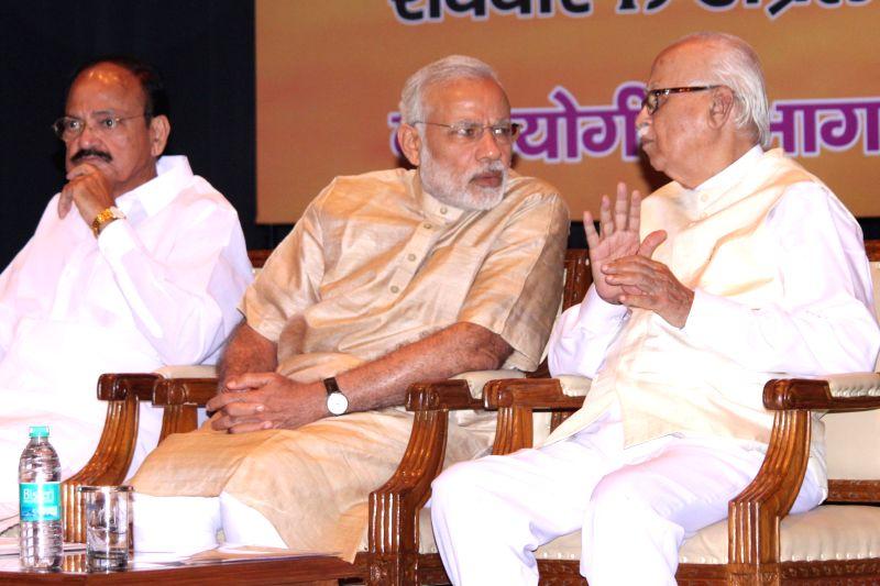 Prime Minister Narendra Modi, senior BJP leader L K Advani and Union Minister, M. Venkaiah Naidu, at the Bharatiya Janata Party's workshop for  Members of Parliament, on pro-poor schemes, ... - Narendra Modi, M. Venkaiah Naidu and L K Advani