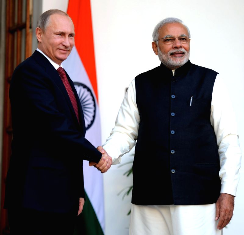 Prime Minister Narendra Modi shakes hands with the Russian President Vladimir Putin at Hyderabad House in New Delhi on Dec. 11, 2014. Putin is on a 24-hour visit to India. - Narendra Modi