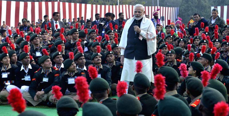 :New Delhi: Prime Minister Narendra Modi talks to the NCC Cadets at Teen Murti Lawns in New Delhi on Jan 27, 2018. (Photo: IANS).