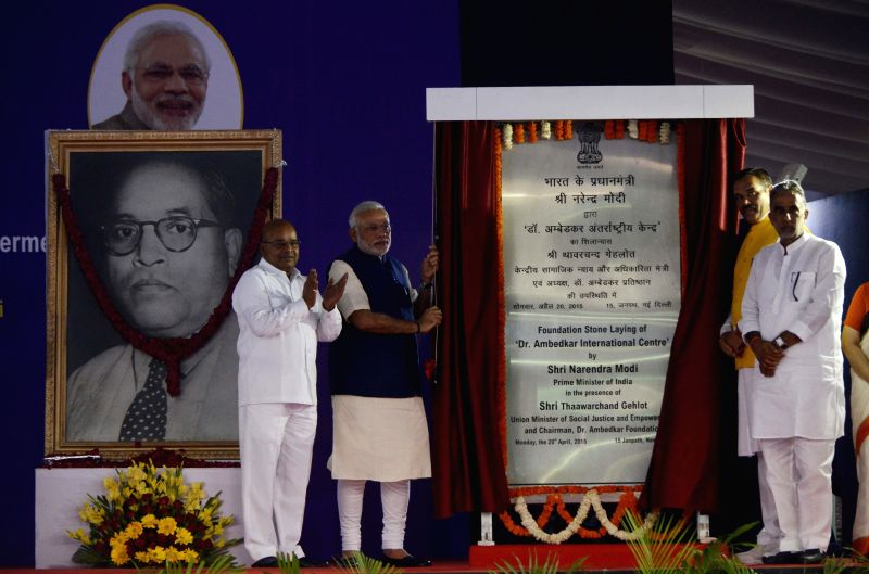 Prime Minister Narendra Modi unveils the plaque to lay the foundation stone of Dr. Ambedkar International Centre, in New Delhi on April 20, 2015. Also seen the Union Minister for Social ... - Narendra Modi, Krishan Pal and Vijay Sampla