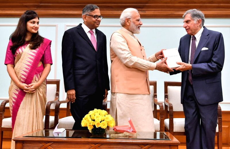 """New Delhi: Prime Minister Narendra Modi unveils the book """"Bridgital Nation: Solving Technology's People Problem"""", written by Tata Sons chairman Natarajan Chandrasekaran and Chief Economist Roopa Purushothaman in New Delhi on Oct 20, 2019. Also seen T"""