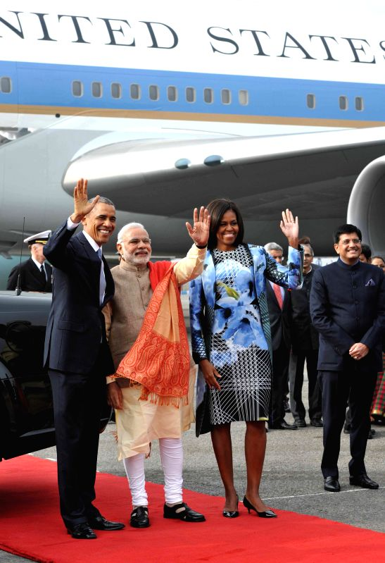Prime Minister Narendra Modi welcomes US President Barack Obama and the US First Lady Michelle Obama on their arrival at Palam Airport in New Delhi, on Jan 25, 2015. - Narendra Modi