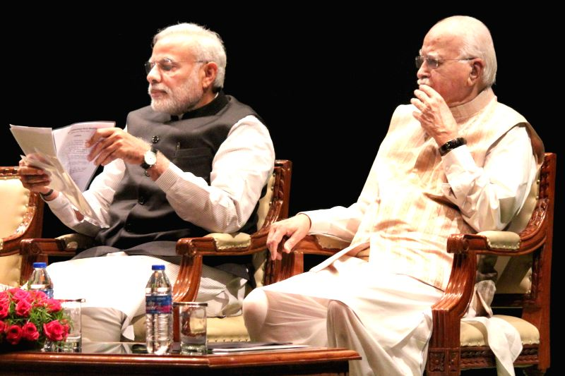 Prime Minister Narendra Modi with veteran BJP leader LK Advani during the the BJP parliamentary party meeting at Parliament library in New Delhi, on March 3, 2015. - Narendra Modi
