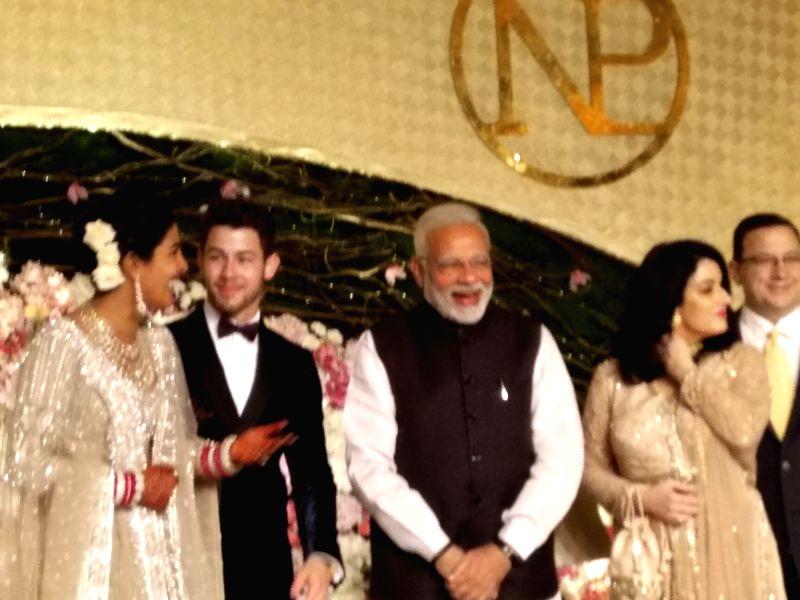 :New Delhi: Prime Minister Narendra Modi with actress Priyanka Chopra and Nick Jonas at their wedding reception in New Delhi on Dec 4, 2018. (Photo: IANS).(Image Source: IANS)