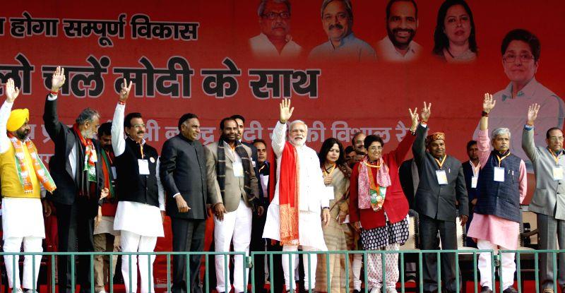 Prime Minister Narendra Modi with BJP leaders Kiran Bedi, Meenakshi Lekhi, Prabhat Jha and Vijay Kumar Malhotra during a rally for the upcoming Delhi Assembly Election in New Delhi on Feb. - Narendra Modi, Kiran Bedi and Vijay Kumar Malhotra