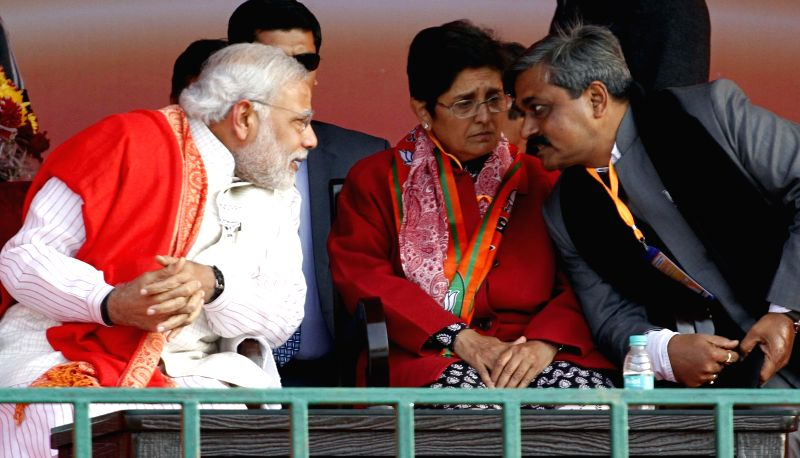 Prime Minister Narendra Modi with BJP's Chief Ministerial candidate for Delhi Kiran Bedi and Delhi BJP chief Satish Upadhyay Satish Upadhyay during a rally for the upcoming Delhi Assembly . - Narendra Modi and Kiran Bedi