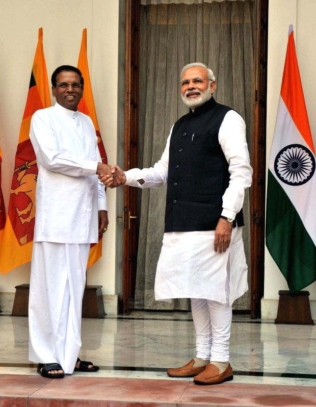 Prime Minister Narendra Modi with the President of the Democratic Socialist Republic of Sri Lanka Maithripala Sirisena, at Hyderabad House, in New Delhi on Feb 16, 2015. - Narendra Modi