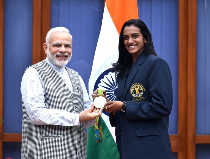 New Delhi: Prime Minister Narendra Modi with the Rio Olympic Silver Medal Winner & Rajiv Gandhi Khel Ratna Awardee of 2016, Indian shuttler P.V. Sindhu, in New Delhi on Aug 28, 2016. (Photo: IANS/PIB)
