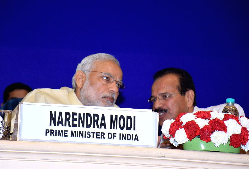 Prime Minister Narendra Modi with Union Law Minister DV Sadananda Gowda during the `Joint Conference of Chief Ministers and Chief Justices of High Courts` in New Delhi, on April 5, 2015. - Narendra Modi