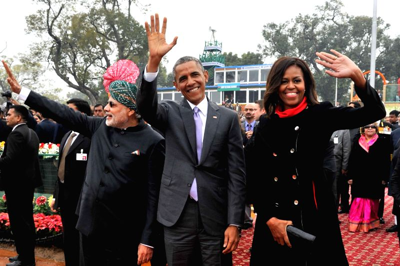 Prime Minister Narendra Modi with US President Barack Obama and the First Lady Michelle Obama at the venue of Republic Day celebrations at Rajpath in New Delhi, on Jan 26, 2015. - Narendra Modi