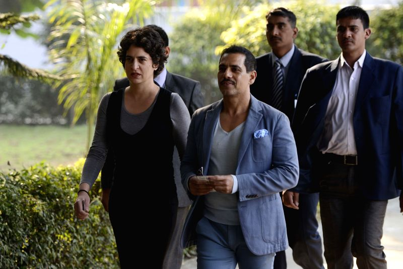 Priyanka Gandhi and her husband Robert Vadra arrive to cast their votes at a polling booth during Delhi Assembly Polls in New Delhi, on Feb 7, 2015.
